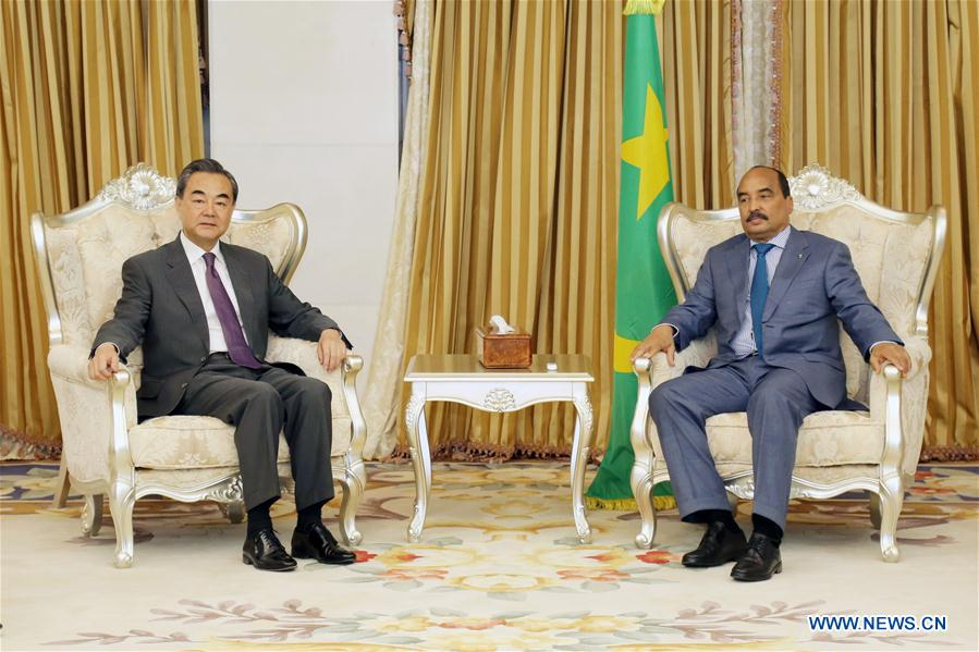 Mauritanian President Mohamed Ould Abdel Aziz (R) meets with Chinese Foreign Minister Wang Yi in Nouakchott, Mauritania