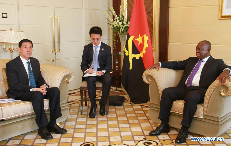 Angolan Vice President Manuel Domingos Vicente (R) meets with visiting Chinese State Councilor Wang Yong (L) in Luanda, Angola.
