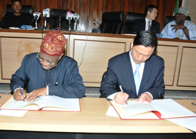 Lai Mohammed, signing a Memorandum of Understanding with the Chinese vice Minister of the State Council Information Office, Mr. Guo Weimin