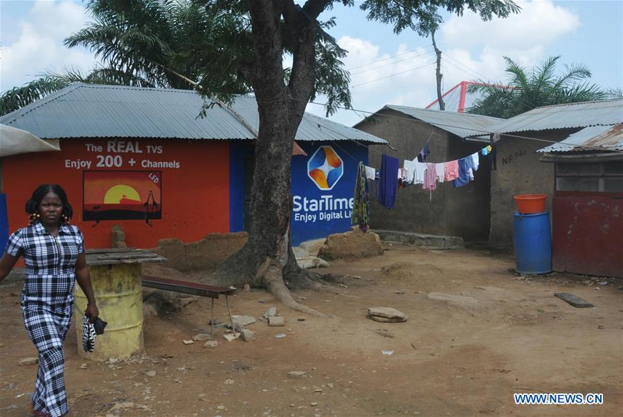 A woman walks past the poster of StarTimes in Hulumi community in the Nigerian capital of Abuja. StarTimes, a Chinese firm which offers direct-to-home pay TV services, introduced its digital TV service to the locality as part of its pilot project to provide satellite TV in five Nigerian villages. The project is a fruit of one of the resolutions of the 2015 summit of Forum On China-Africa Cooperation, in Johannesburg, South Africa, in which the Chinese government pledged to provide satellite TV in 10,000 African villages.