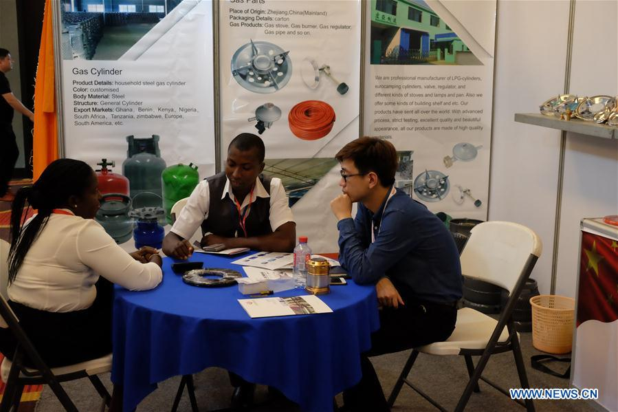 Visitors communicate with an exhibitor (R) during the China Trade Week in Accra, Ghana, on May 17, 2017. Approximately 50 Chinese companies selected from various sectors, including power energy, lighting, home electronics, construction, Information and Communications Technology (ICT), clothing and textiles as well as personal care participated in the China Trade Week which kicked off